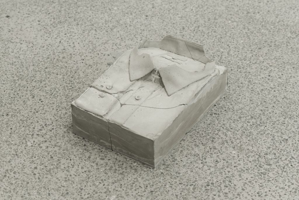 Extend and Compress, Part 2, 2013 (re-configured 2016) Concrete, chewing Gum Shirt 30 x 18 x 11 cm, Button 3 x 3 x 1 cm Rowena Harris